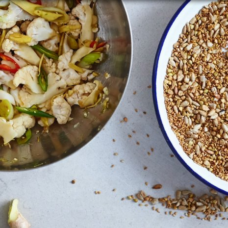 Spicy zesty cauliflower quick-pickle with crunchy savoury seed topping